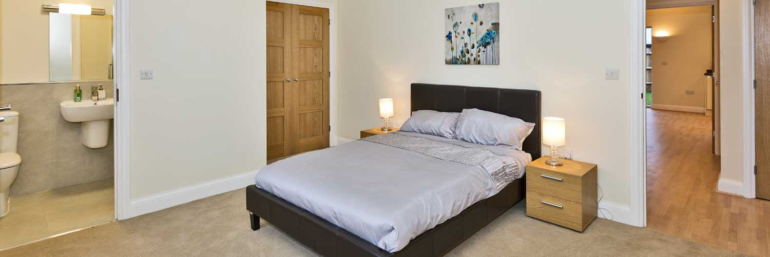 Typical bright bedroom with classic white ensuite at Langborough Court
